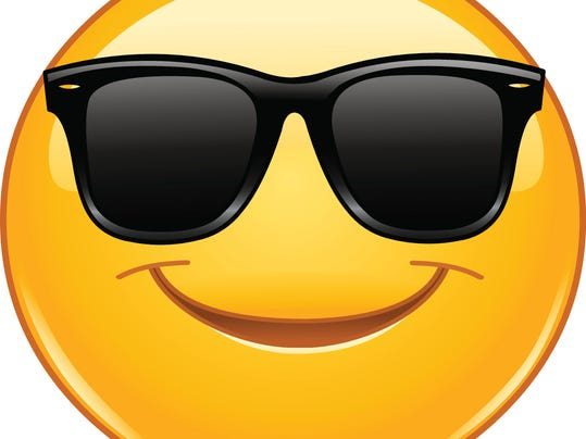 Smiling emoticon with sunglasses