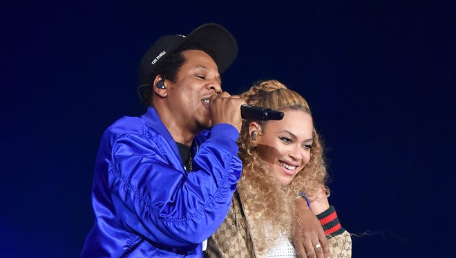"Jay-Z and Beyonce at the ""On the Run II Tour"" opener in Cardiff, England."