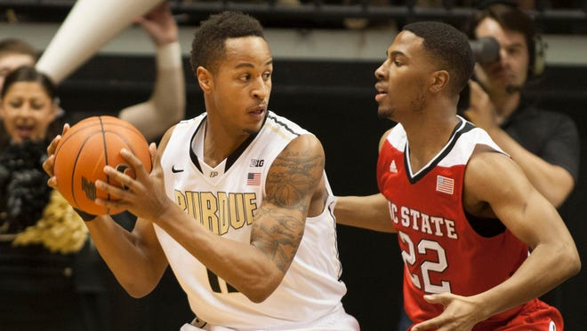 Purdue Boilermakers forward Vince Edwards (12) holds the ball as North Carolina State Wolfpack guard Ralston Turner (22) defends in the first half at Mackey Arena. The Boilermakers won 66-61.