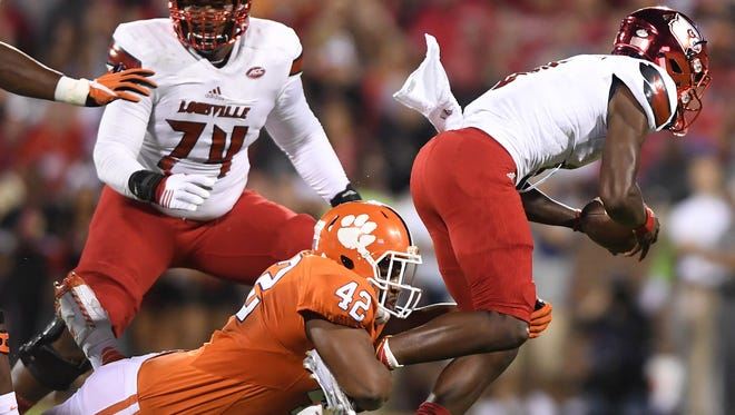 Clemson's Christian Wilkins records one of five sacks last season against Louisville quarterback Lamar Jackson.