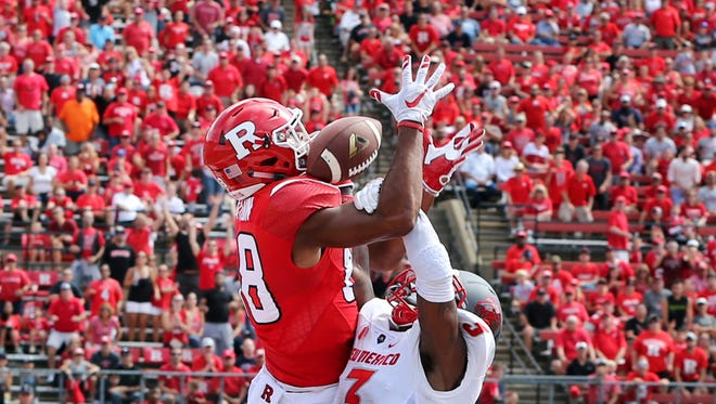 Rutgers wide receiver Andre Patton (88) catches a pass for a touchdown as New Mexico's Richard McQuarley (3) defends during the first half on Saturday in Piscataway.