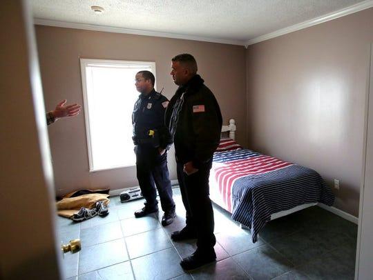 February 26, 2016 - Officer Chris Ross (left) speaks