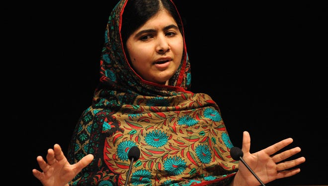 Malala Yousafzai speaks during a media conference at the Library of Birmingham in England on Oct. 10 after she was named as winner of the Nobel Peace Prize.