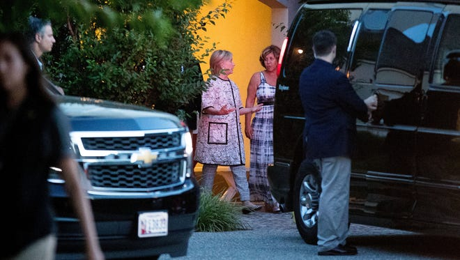 Democratic presidential candidate Hillary Clinton, center left, leaves the home of Marcia Riklis, center right, following a private fundraiser in Southampton, N.Y., Sunday, Aug. 28, 2016.