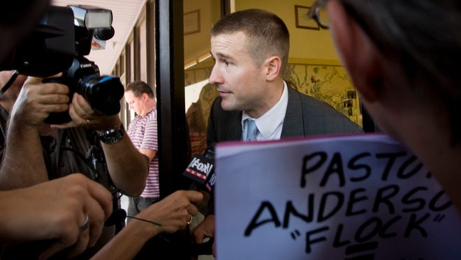 Faithful Word Baptist Church pastor Steven Anderson pokes his head out of the door after Sunday services in Tempe September 6, 2009. The Botswana government announced September 20, 2016, that it will deport Anderson after he made anti-gay comments.