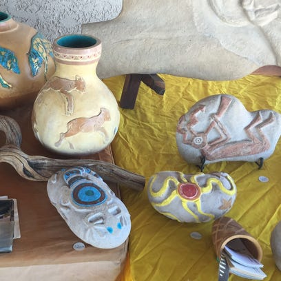 Art displayed at a Salton Sea fundraiser Saturday. Activist groups want to fill the withering lake with water from Mexico's Sea of Cortez.