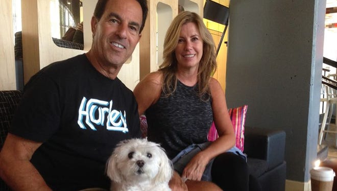 """Michael and Joanne Chester relax in the Aloft lobby on Friday afternoon with their Maltese named Pixi. They hail from Boca Raton. """"It (Boca) is a great place to be - if you're not having a storm,"""" Michael said."""