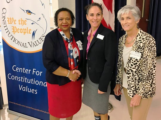 Stuart City Commissioner  Eula Clarke, left, Charlene Lyons, YMCA Youth in Government and Kate Boland, CCV Chair at the Center for Constitutional Values Constitution Academic Competition.