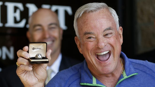 NFL Hall of Famer Lance Alworth displays his 1992 Super Bowl ring that was stolen 21 years ago and returned by the San Diego County Sheriff office in Encinitas, Calif.