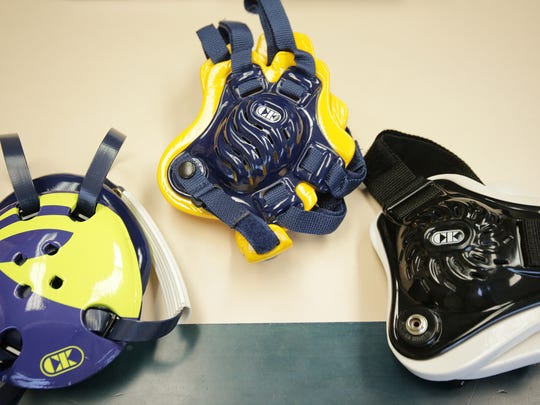 These are Cliff Keen wrestling head gear photographed at Cliff Keen Athetics in Ann Arbor on Oct. 29. They are from left: Four Strap, Tornado and Twister.