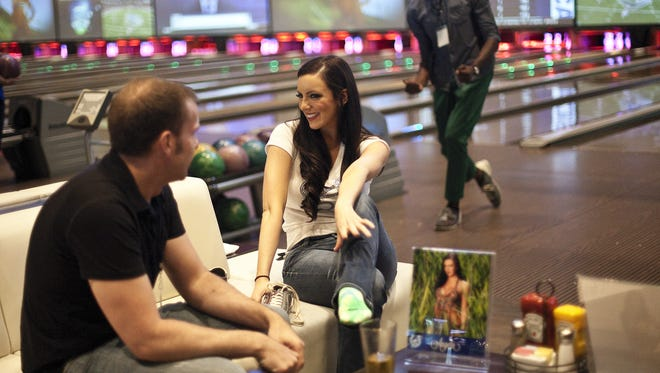 Colts Cheerleader Angela puts on her bowling shoes at the Calendar Launch Party on Friday, July 26, 2013, at Latitude 360.I