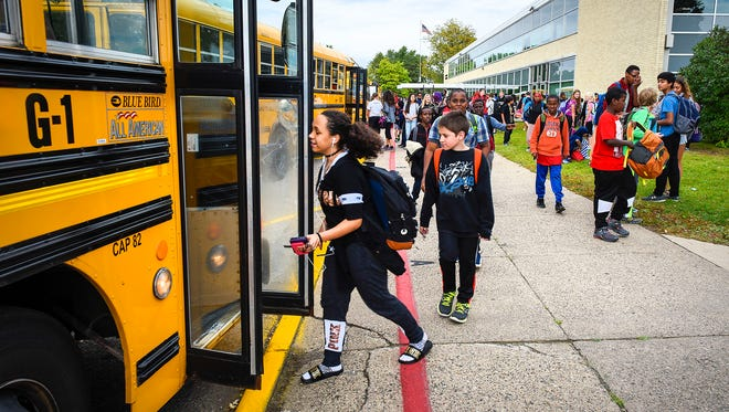 Students head to their buses Thursday, Sept. 28, at South Junior High School. Enrollment in the St. Cloud school district is up nearly 3 percent, an increase of more than 250 students.