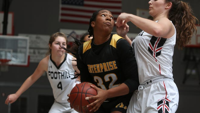 Enterprise's Justyse Cooper looks for an open shot against Foothill's Jenna Wallace during the Hornets' 52-45 win over the Cougars on Thursday night.