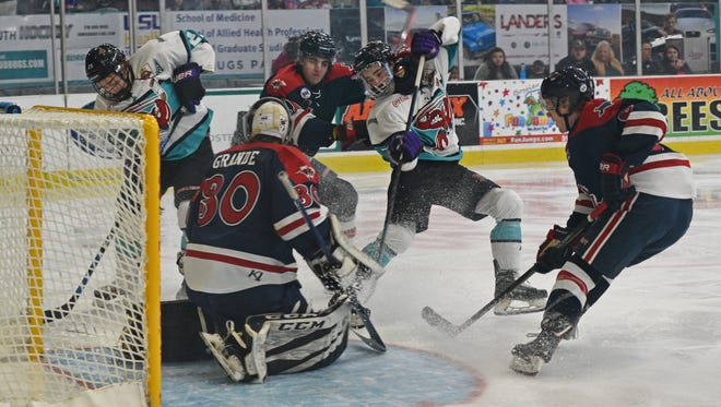 The Mudbugs fight to score in front of the goal  against Amarillo Friday at The Pond.