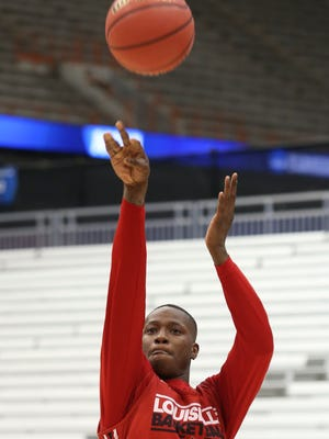U of L's Terry Rozier, #0, shoots during practice ahead of playing NC State in the Sweet 16 Tournament in Syracuse, NY.March 26, 2015