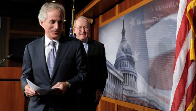 Sen. Bob Corker, R-Tenn., left, and Sen. Lamar Alexander, R-Tenn., leave a news conference in Washington on Dec. 28, 2012.