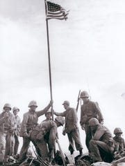 The soldiers who just raised the first flag at Iwo