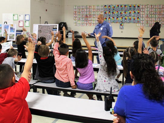 "Carlos Almaraz, LCU wastewater operator, quizzes Highland Elementary students to reinforce what they heard during the presentation; one takeaway message is: ""Your toilet is not a trash can!"" Never flush any kind of drugs or baby wipes down the drain or toilet."