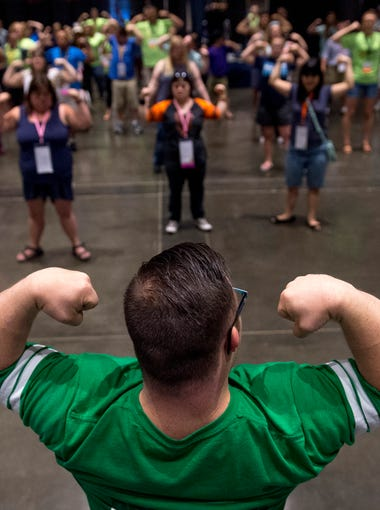 Bodybuilder and fitness fan Collin Clarke of Evansville, Ind., leads attendees in a series of poses at the National Down Syndrome Convention in Sacramento, Calif., in July of 2017. Because of the reshaping of his lifestyle and his dedication to physical fitness, Collin has become a celebrity and even started his own inspirational brand #collinnation. Once weighing in at more than 200 pounds with a sedentary lifestyle, Collin last competed in March of 2018 at 148 pounds of solid muscle.