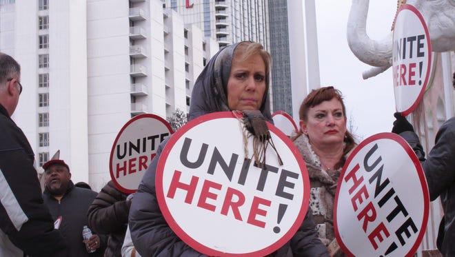 Members of the Unite-HERE casino workers union picket outside the Trump Taj Mahal Casino in Atlantic City in 2015.
