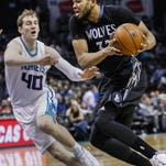 Minnesota Timberwolves center Karl-Anthony Towns, right. drives past Charlotte Hornets center Cody Zeller in the second half of an NBA basketball game in Charlotte, N.C., Monday. Charlotte won 108-103.