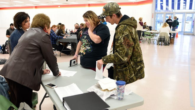 Robert and Michele Davis, right, talk with Emily Whaley and Janice Bettis with Sevier County Economic Development about area job opportunities at the former Belz Factory Mall in Pigeon Forge Monday, December 12, 2016.  The Multi-Agency Resource Center will be open Monday ÐSaturday, 10 am - 6 pm., providing needed assistance to fire victims who have lost their homes, who were displaced by the fire or businesses who need help.
