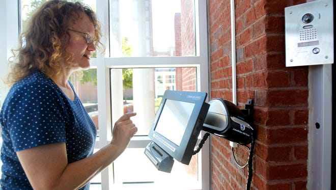 Donna Simmons uses the LobbyGuard, a new security measure, at Northside High School in Roanoke, Va. Roanoke city and county have installed the ID card-reading systems.