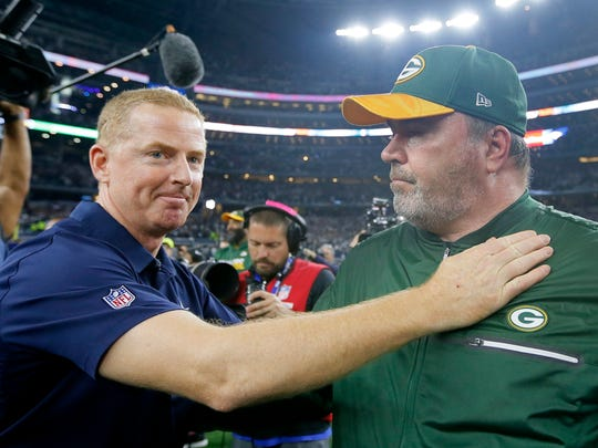 FILE - In this Jan. 15, 2017, file photo, Dallas Cowboys coach Jason Garrett, left, congratulates Green Bay Packers coach Mike McCarthy after their 34-31 win in an NFL divisional playoff football game in Arlington, Texas. The Dallas Cowboys didn't take long to settle on Mike McCarthy as their coach after waiting a week to announce they were moving on from Jason Garrett. McCarthy, who won a Super Bowl at the home of the Cowboys nine years ago as Green Bay's coach, has agreed to become the ninth coach in team history, a person with direct knowledge of the deal said Monday, Jan. 6, 2020.The person spoke to The Associated Press on condition of anonymity because the team hasn't announced the move. (AP Photo/Tony Gutierrez, File)
