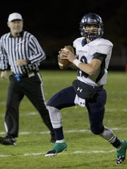 Damonte Ranch quarterback Cade McNamara rolls out against Galena