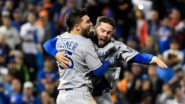 Mike Moustakas, right, and Eric Hosmer celebrate winning the 2015 World Series.