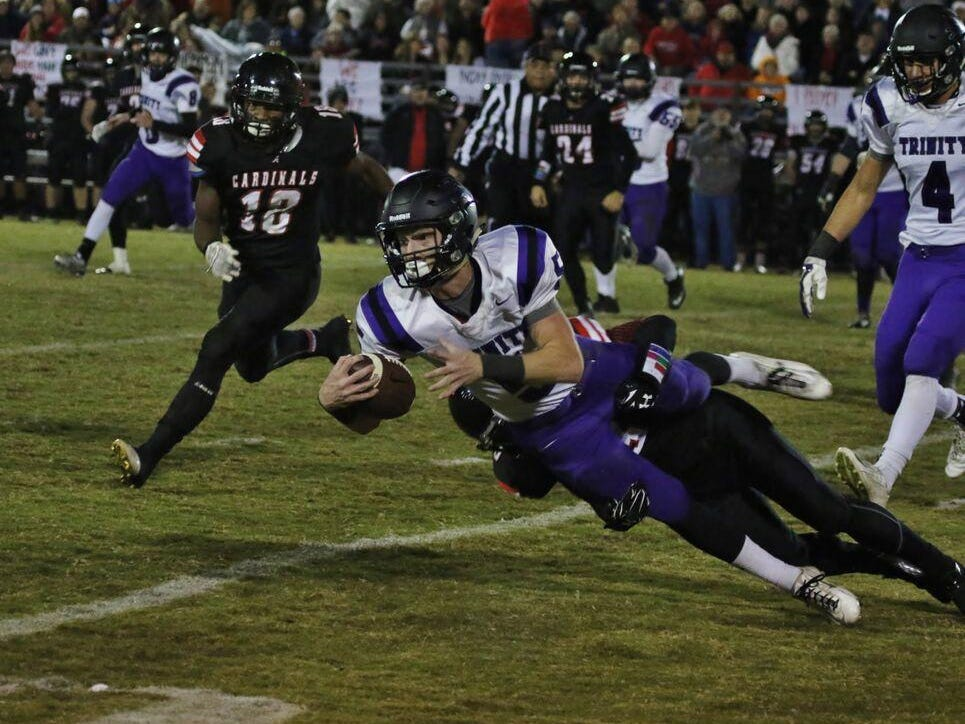 Trinity Christian's Eli Parker reaches out for a gain on Nov. 13 against Adamsville.
