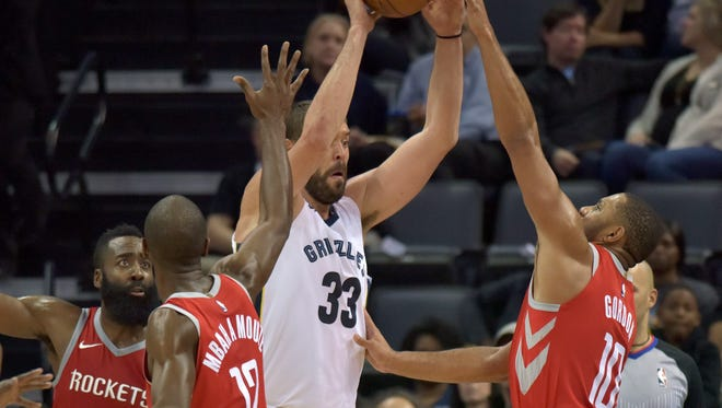 Memphis Grizzlies center Marc Gasol (33) controls the ball against Houston Rockets guard James Harden, left, forward Luc Richard Mbah a Moute (12) and guard Eric Gordon (10) during the first half of an NBA basketball game Saturday, Nov. 18, 2017, in Memphis, Tenn. (AP Photo/Brandon Dill)