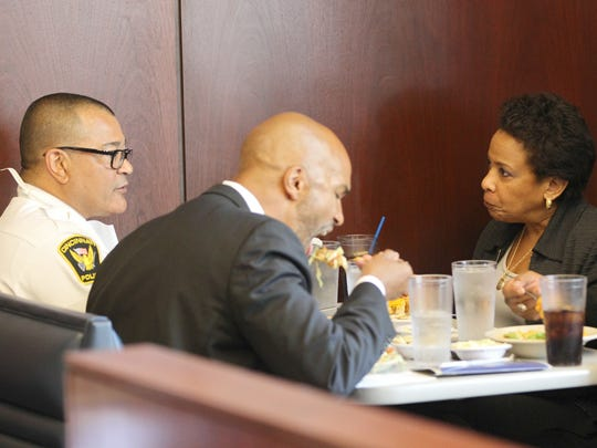 From left: Cincinnati Chief of Police Jeffrey Blackwell, United States Attorney for the Southern District of Ohio Carter M. Stewart, U.S. Attorney General Loretta Lynch and Director of Community Oriented Policing Services Ron Davis, eat Cincinnati chili at the Skyline Chili location at Fourth and Sycamore streets in downtown Cincinnati, Tuesday. Lynch ordered two cheese coneys with mustard and no onions.
