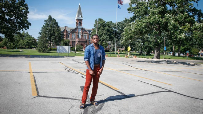 Bakari Caldwell, a student leader at Drake University, stands near the site of the new hotel expansion project near Old Main.