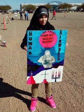 Safa Awadalla holds a sign at a protest at Donald Trump