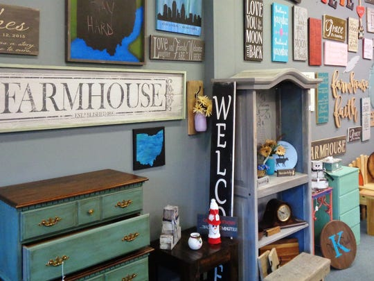 Some of the custom-crafted signs by Jeanne Duke at