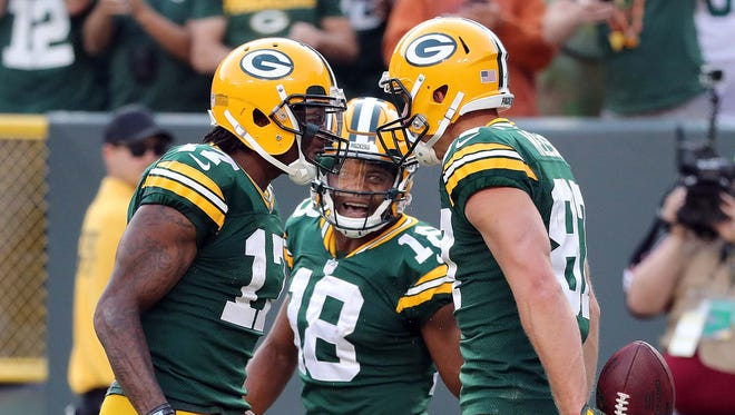 Packers wide receiver Jordy Nelson (right) is congratulated by fellow receivers Davante Adams (17) and Randall Cobb after Nelson's TD catch in the season opener against the Seahawks.