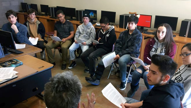 In this Jan. 18, 2018, photo, english and college-preparation teacher Rhonda Gardner, bottom, leads a discussion about how to adjust to the academic, financial and social pressures of collegiate life for high school seniors at the Academy for Technology and the Classics in Santa Fe.