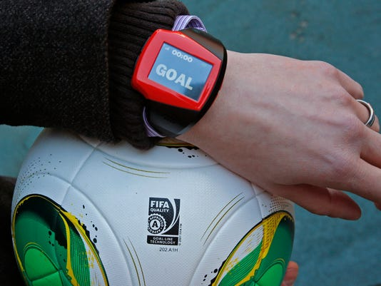 """FILE - The Dec. 8, 2012 file photo shows a referee's watch with the goal as they demonstrate the goal-line technology of Hawk-Eye system at Toyota stadium in Toyota. After PSV Eindhoven goalkeeper Jeroen Zoet made the save, he made a costly mistake on Sunday Feb. 26, 2017. Zoet saved a close-range header from Feyenoord defender Jan-Arie van der Heijden, but as he clutched the ball to his chest, a screen on referee Bas Nijhuis' wrist lit up. Nijhuis looked down, saw the word """"goal"""" flashing on the screen and awarded the Dutch league leaders the winning score in a 2-1 victory. (AP Photo/Shuji Kajiyama/File)"""