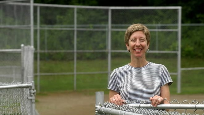 In this 2003 file photo, Sue Peters stands at Henry Field, where she played softball as a youth in Southbridge.