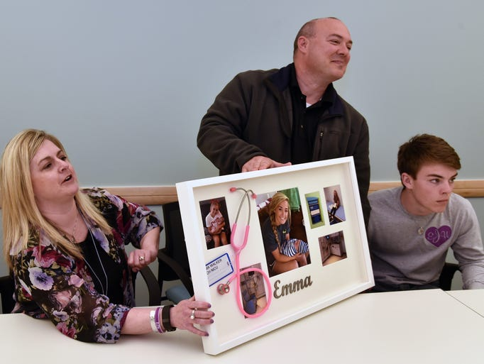 The family of Emma Walker pose with a memory board