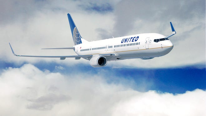 A United Airlines Boeing 737 soars through the sky. A similar plane made an emergency landing at Dover Air Force Base Monday night.
