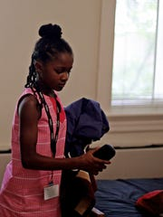 Cellist Kendall Gonzales of Hampton puts her things away in her room on arrival day for participants in HeifetzPEG, or Program for the Exceptionally Gifted, on July 14, 2016 at Mary Baldwin University. The PEG students, aged 8 to 13, come from all over the country to learn in the stringed instrument program. The Institute received a $25,000 grant from NEA Program Art Works for the program; funding that would disappear if Trump's 2018 Federal Budget proposal is approved.