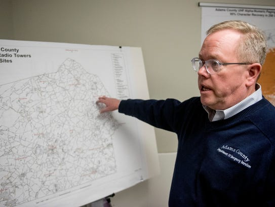John Eline points to satellite location of one of Adams
