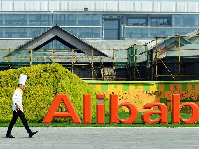 A chef walks into the headquarters of the Alibaba Group on Aug. 27 in Hangzhou, China.