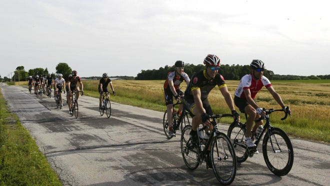 A bike group that gathers every Wednesday at Bicycle Works in Sheboygan Falls is shown traveling north along Meadowlark Road. The group travels north or south depending on wind direction.
