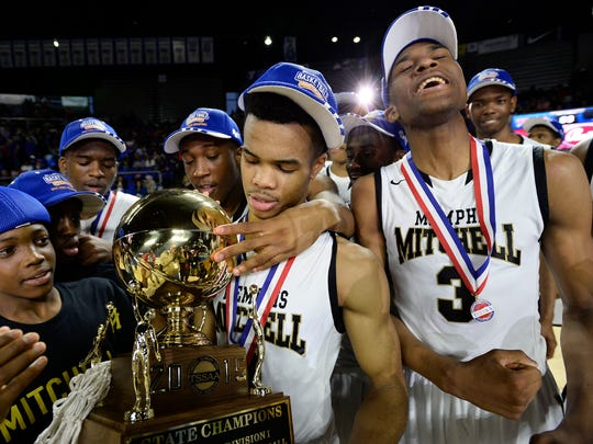 Mitchell's Kylan Phillips, center, and Jeremiah Martin (3) celebrate following their win against Union City in the Tennessee Division I A boys' high school basketball championship Saturday, March 14, 2015, in Murfreesboro, Tenn. Mitchell won 69-39.