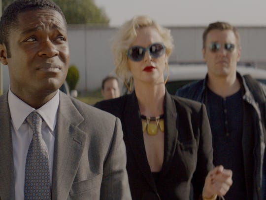 "David Oyelowo (from left), Charlize Theron and Joel Edgerton star in ""Gringo."""