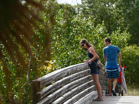 Patrons use a bridge Saturday, Dec. 5, 2015, at Lovers Key State Park.