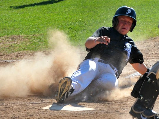 Plover designated hitter DJ Drohner slides into home